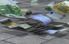 EUR_euro_down_the_street-drain